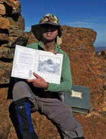 Simon Cameron with logbook from Mt Hack