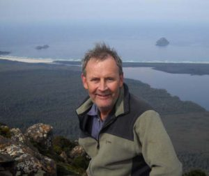 Mark Proctor on top of Precipitous Bluff, Tasmania 2010